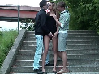 European threesome in public. Tall girl