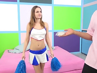 A slutty cheerleader sheds her uniform and gets pounded
