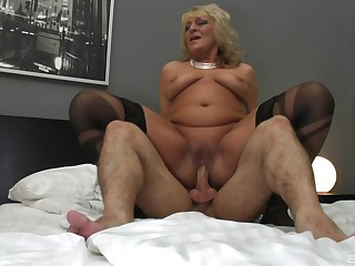 Granny seems ready to jizz her saggy tits with cum